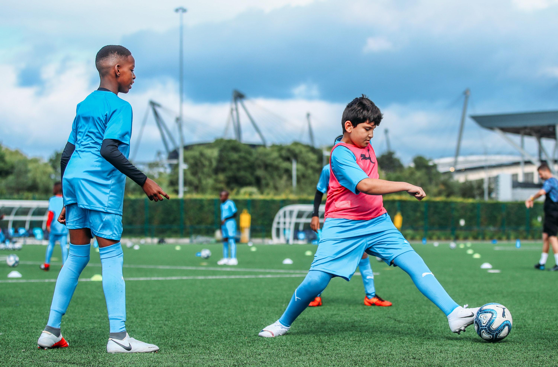 a group of boys training football