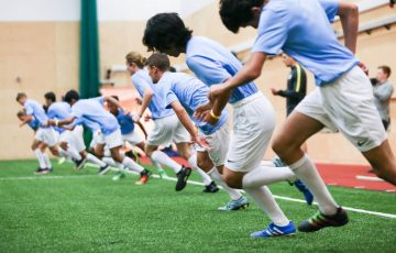 a group of students training football indoor